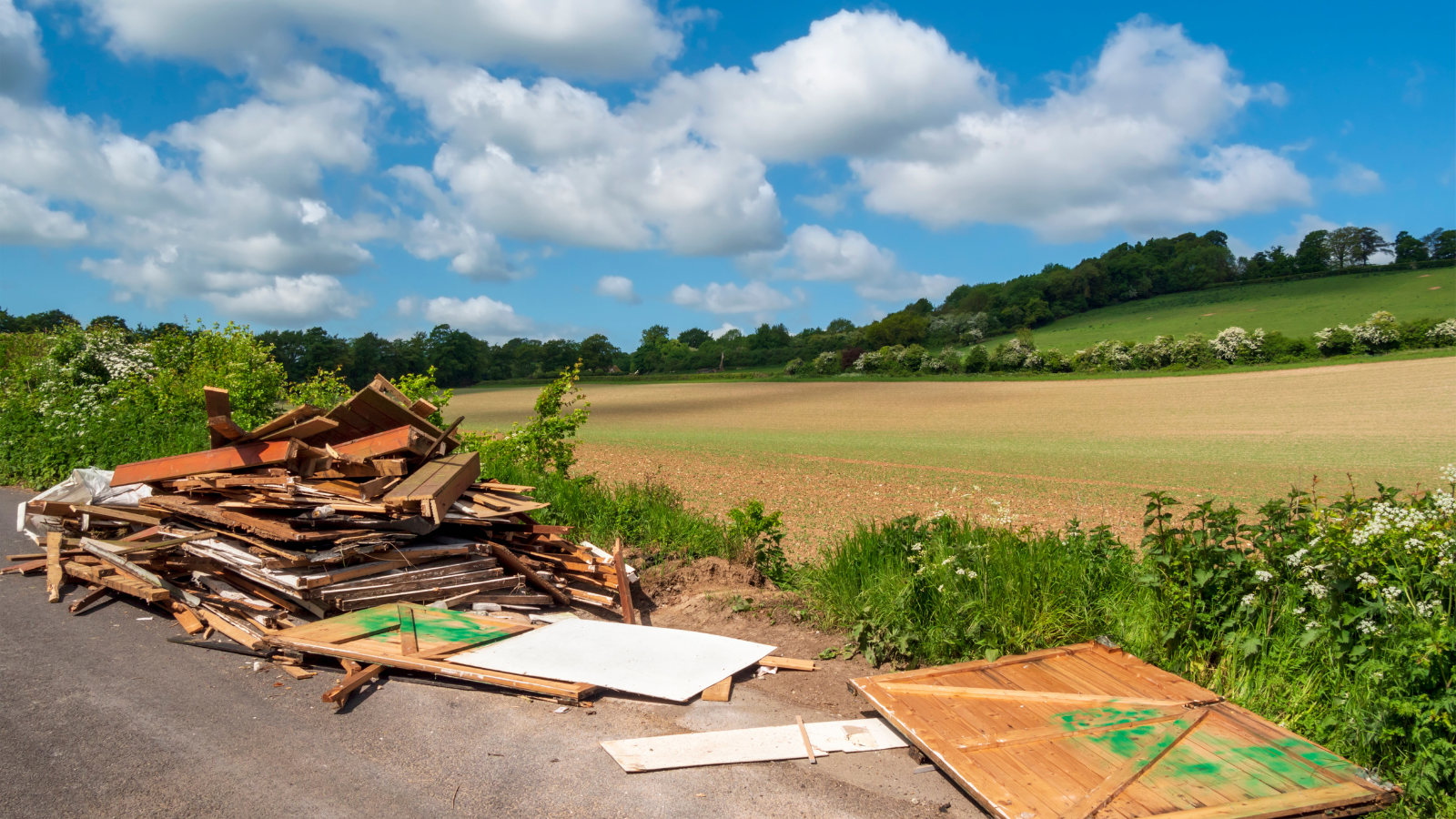 Fly-tipped waste in English countryside