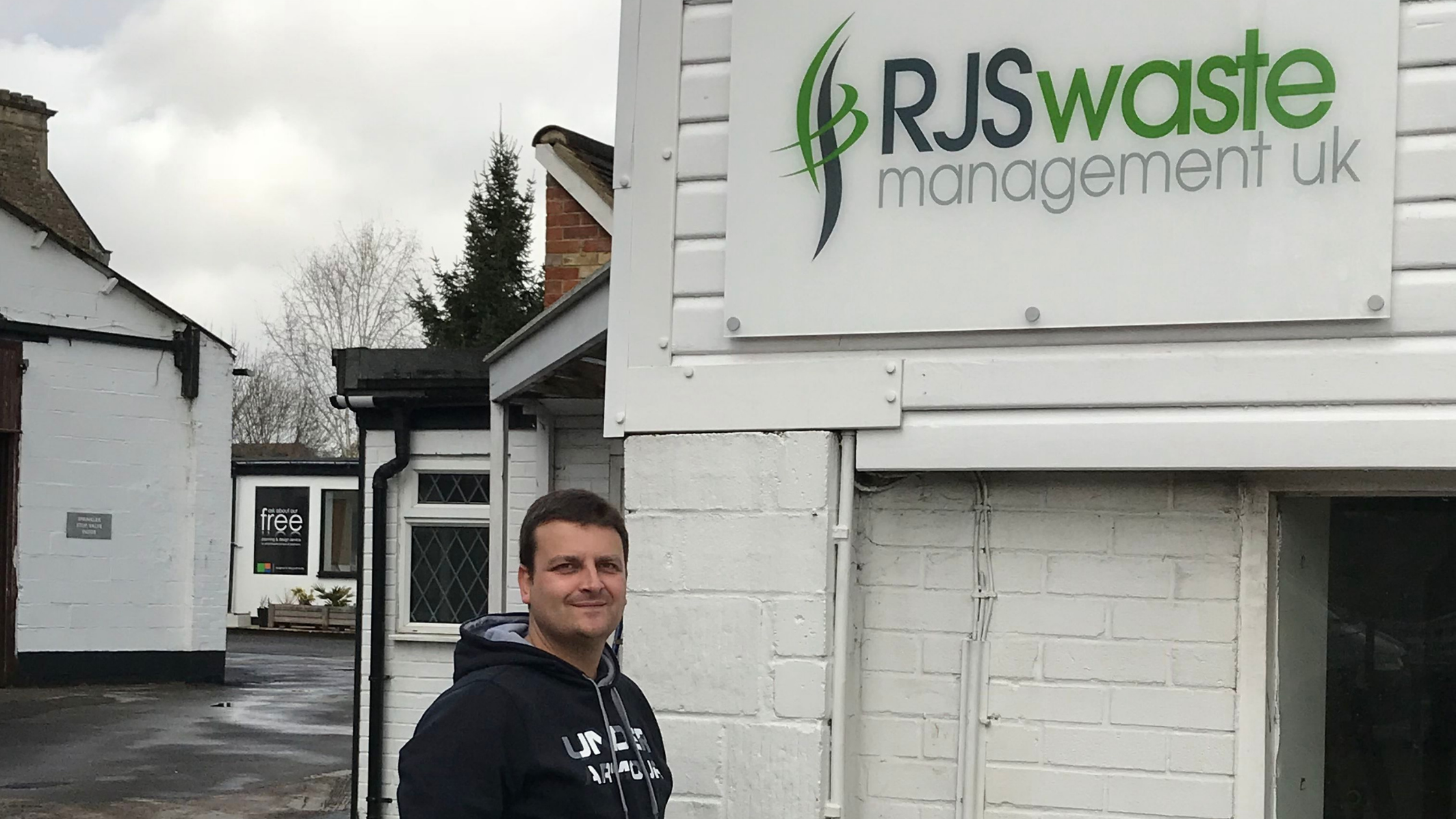 Russell Shrives outside RJS Waste Management Oxford Office